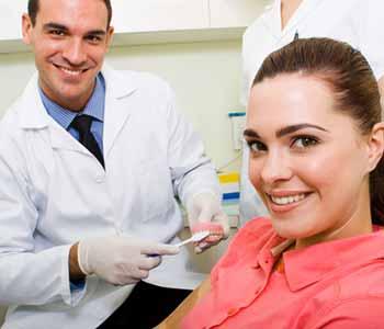 Lady sitting at a dentist